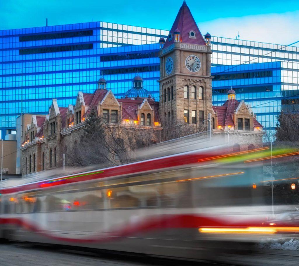 Calgary, Alberta -  C-Train passing city hall. Photographer Carlos Amat, www.carlosamat.ca