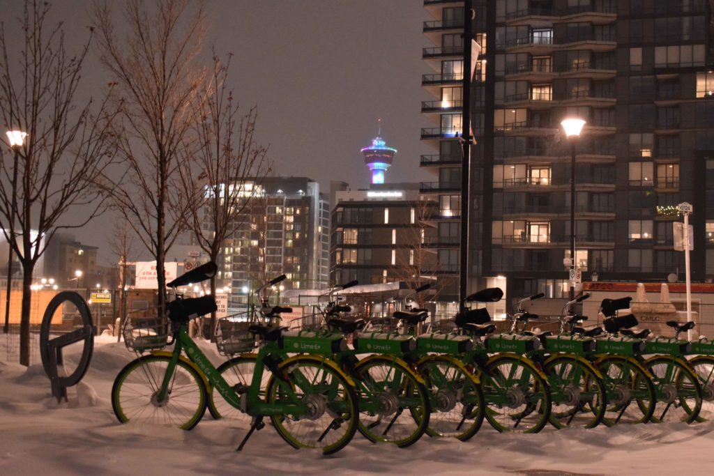 www.IamCalgary.ca I Am Calgary YYC Staycation East Village Snowy Calgary Tower Lime Bikes