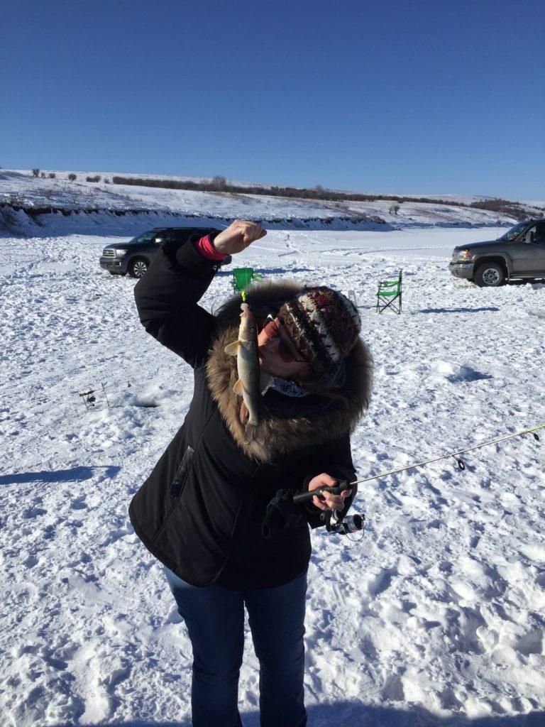 www.IAmCalgary.ca I Am Calgary Ice Fishing Christa CMD kissing fish