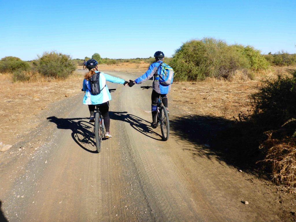 www.iamcalgary.ca IAmCalgary I Am Calgary Botswana Mashatu Cycle Delmar holding hands